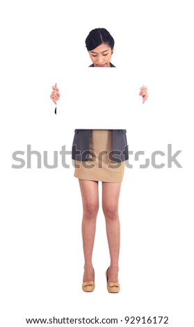 Asian business woman holding a blank billboard on white - stock photo