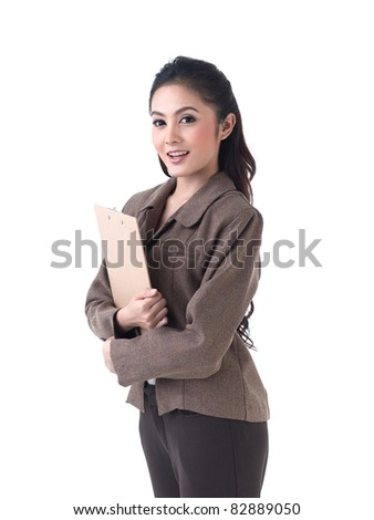 Asian business woman holding a clipboard - stock photo