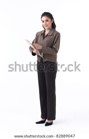 Asian business woman holding a clipboard and prepare to write - stock photo