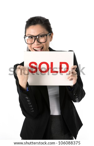 Asian Business woman holding a 'Solds' white sign and cheering. - stock photo