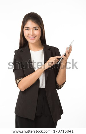 Asian business woman holding a tablet. Isolated on white background.