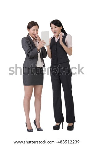 Asian business woman holding pad, full length portrait on white background.
