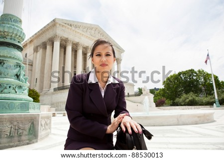 Asian business woman in front of the Supreme Court building in Washington DC - stock photo