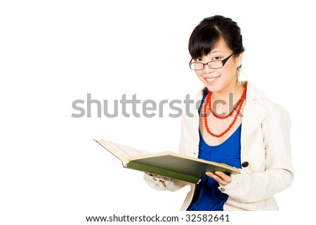 Asian business woman in glasses reading and smiling - stock photo