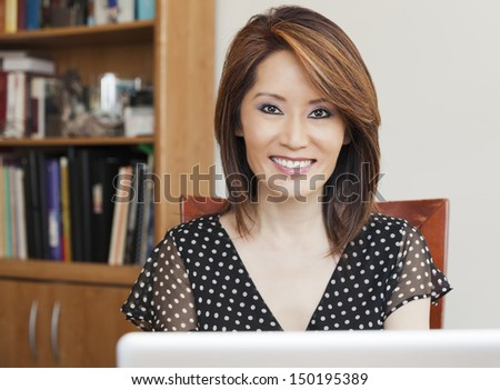 Asian business woman in her office - stock photo