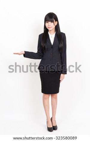 asian business woman in welcome pose with open hand isolated on white background