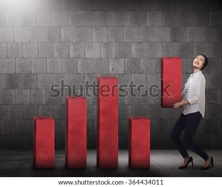 Asian business woman lifting chart block. Business challenge concept
