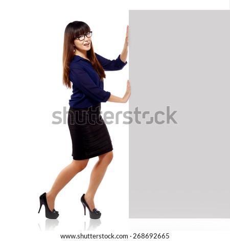 Asian business woman push ads board isolated over white background. You can put your message here - stock photo