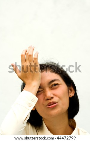 asian business woman seems to forget of something important - stock photo