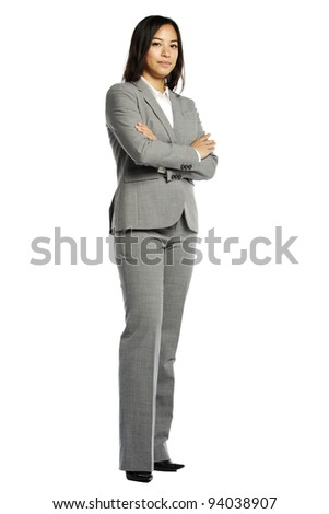 Asian business woman serious with crossed arms against white background - stock photo