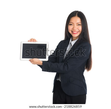 asian business woman showing off tablet