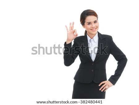 Asian business woman showing ok sign isolated on white background - stock photo