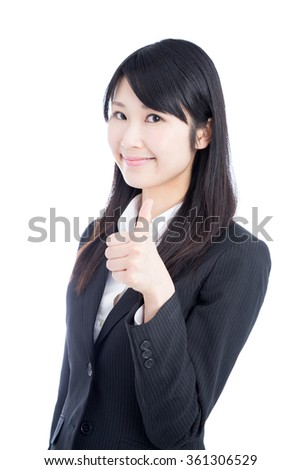Asian business woman showing thumb up gesture isolated on white background. - stock photo
