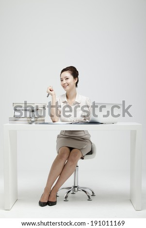 Asian business woman sitting at desk