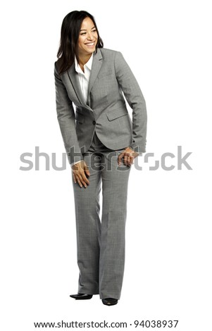 Asian business woman smiling and looking to side against white background - stock photo