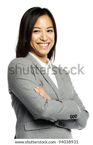 Asian business woman smiling with crossed arms against white background - stock photo