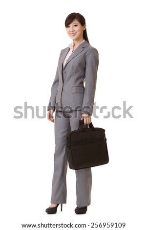 Asian business woman standing and holding briefcase, full length portrait isolated on white background. - stock photo