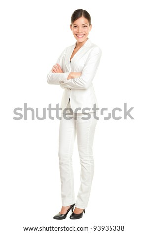 Asian business woman standing proud and confident in white suit isolated on white background in full body. Beautiful young mixed race Chinese Asian / Caucasian female businesswoman smiling happy. - stock photo