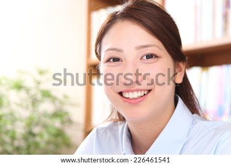 Asian business woman to smile - stock photo