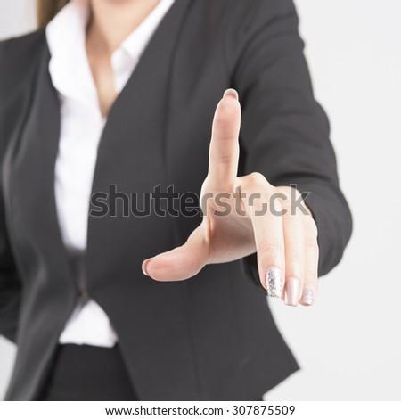 Asian Business Woman Touching Transparent Screen - stock photo