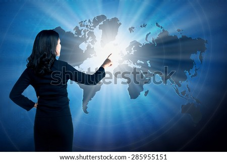 Asian business woman touching world on virtual screen. globalization business concept