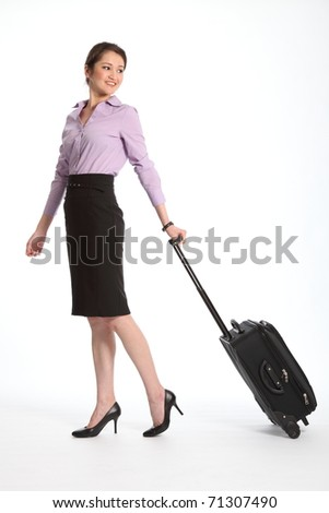 Asian business woman traveling with suitcase - stock photo