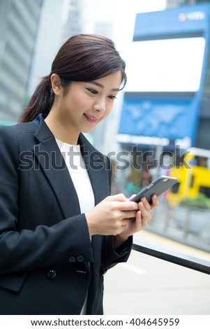 Asian business woman use of mobile phone