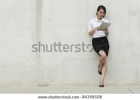 Asian  Business woman using a Digital Tablet - stock photo