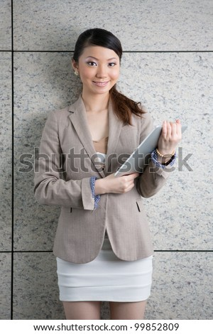 Asian Business woman using a touch pad. - stock photo