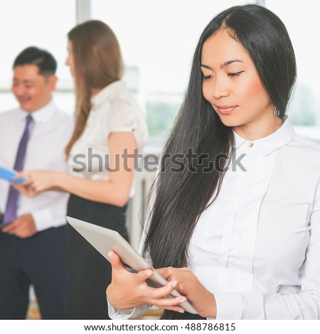 Asian business woman using tablet PC. Online banking. Group people. Risk managing. Business plan