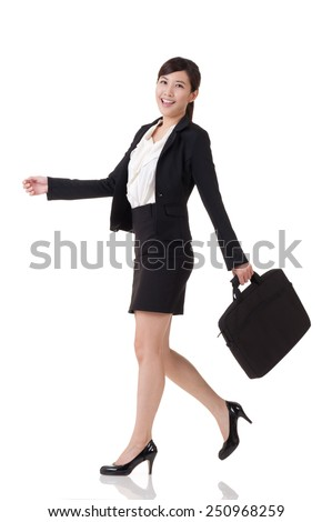 Asian business woman walking, full length portrait with reflection on studio white background. - stock photo