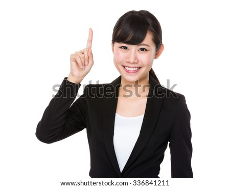 Asian business woman with finger point up - stock photo