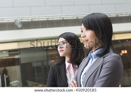 Asian business woman with her colleague.