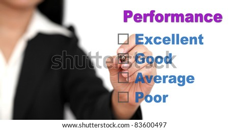 Asian business woman writing on performance audit checklist - stock photo