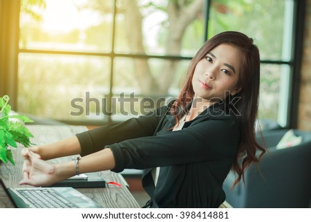 Asian business women to exercise to reduce fatigue from work,soft focus - stock photo