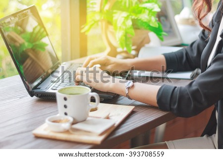 Asian business women using notebook for working ,blurry and soft focus - stock photo