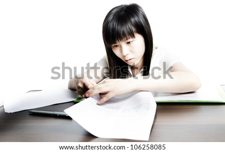 Asian business women work with paper documents - stock photo
