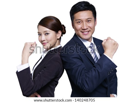 asian businessman and businesswoman standing back to back, making a fist - stock photo