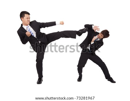 Asian Businessman are fighting by kung fu - stock photo