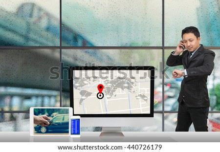 Asian businessman calling mobile phone,Computer showing part of navigator map on traffic jam with Rain drop On the window Glass,Elements of this image furnished by NASA,Business transportation concept - stock photo