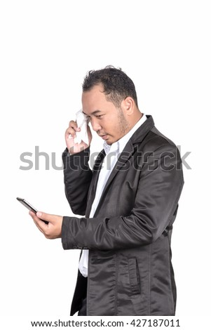 asian businessman depressed and worried about business when he saw massage in smart phone on his hand, Distress concept