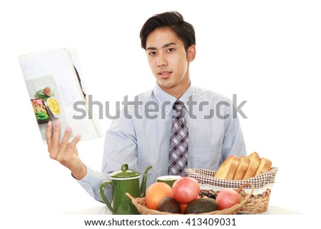 Asian businessman eating meals - stock photo