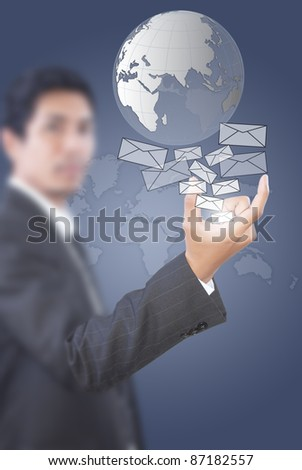 Asian businessman giving mail and globe. - stock photo