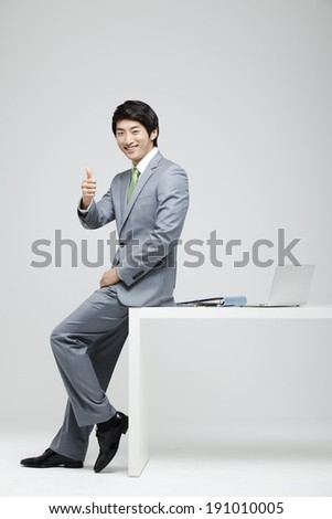 Asian businessman giving thumbs up