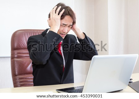Asian Businessman has stress and failures in the performance, or Computer equipment was defective at the time of urgency