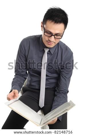Asian businessman holding a folder. Isolated on white background - stock photo