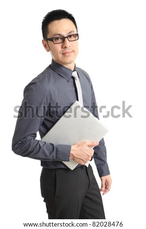 Asian businessman holding a laptop. Isolated on white background.