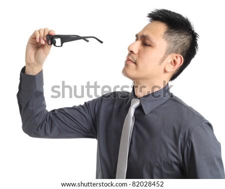 Asian businessman holding eye glasses. Isolated on white background - stock photo