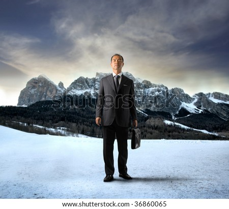 asian businessman in a mountain landscape - stock photo