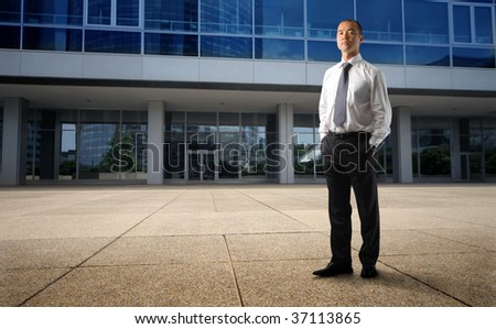 asian businessman in front of his corporate - stock photo